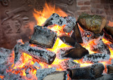 Glowing coals in a wood fire Stock Photography