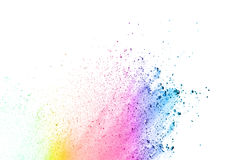 Glowing color powder on white background stock photos