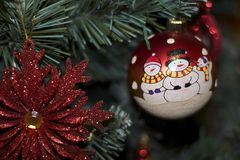 Glowing colorful chirtmas ball on the christmas tree Stock Images