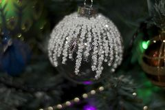 Glowing colorful chirtmas balls on the christmas tree Stock Photography