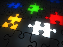 Glowing colorful jigsaw pieces. Red, white, yellow, green and blue Royalty Free Stock Image
