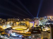 Glowing Colorful Malaga city in night Royalty Free Stock Photo