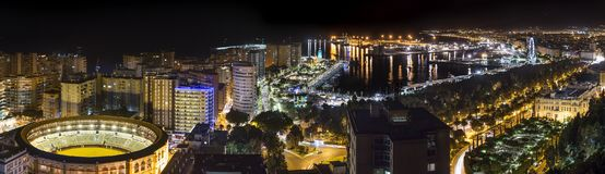 Glowing Colorful Malaga city in night Stock Photos