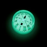 Glowing compass 2. Fluorescent compass in the dark stock image