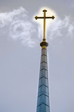 Glowing Cross. On church tower Stock Photo
