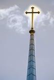 Glowing Cross. On church tower stock photo