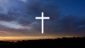 Glowing cross in sky . Cross against the sky . Happy Easter. Light from sky . Religion background stock photos