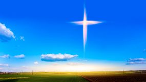 Religion symbol shape .  Dramatic nature background. Glowing cross in sky . Happy Easter. Light from sky . Religion background .  Paradise heaven . Light in sky royalty free stock photo