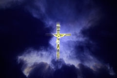 Glowing crucifix among clouds Stock Images