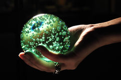 Glowing Crystal Ball. On Hand Stock Images
