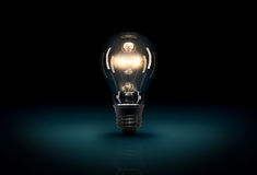 Glowing 3D light bulb on dark blue background Stock Images