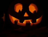 Glowing in a dark Jack-o'-lantern pumpkin Royalty Free Stock Photo