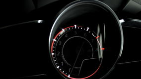 Glowing dashboard showing start and stop car engine with backlight stock video footage