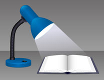 Glowing desk lamp. Stock Photo