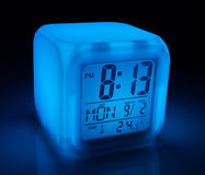 Glowing digital alarm clock with date and temperature Royalty Free Stock Photography