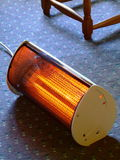 Glowing Electric Heater. A small radiant electric heater on the floor Stock Photography