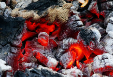 Glowing embers in the ash closeup Stock Image