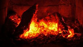 Glowing embers in a fireplace - close up stock video footage