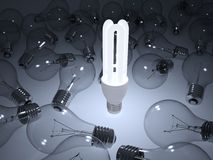 Glowing energy saving light bulb Royalty Free Stock Image