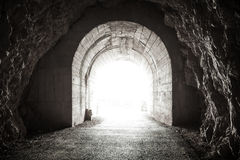 Glowing exit from dark tunnel Royalty Free Stock Images