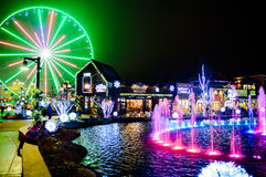 Glowing Farris Wheel And Fountain Royalty Free Stock Photos