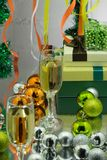 Glowing festive garland and champagne with candies on its background. Glowing festive garland and champagne with candies on its background Stock Photos