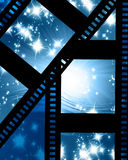 Glowing film strip. On a blue background Stock Photos