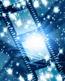 Glowing filmstrip. Glowing film strip on a blue background Stock Photo
