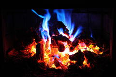 Glowing fire embers at night Stock Photography