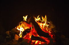 Glowing fire embers at night Stock Photos
