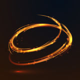 Glowing fire gold circle light effect on black background Stock Image