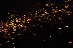 Glowing Flow of Sparks in the Dark Stock Photography