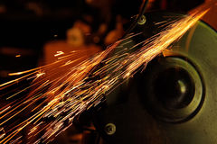 Glowing Flow of Sparks from Grinder Stock Images