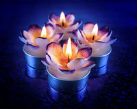 Glowing flower shaped candles Royalty Free Stock Photo