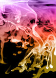 Glowing fluid abstract. Intense colours - fluid patterns on black Stock Photos