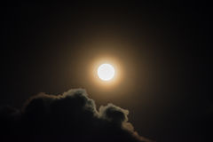 Glowing full moon and clouds. Background Stock Image