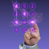 Glowing futuristic keypad in purple. Shiny keypad back view with glowing touches in purple with a hand entering a 4 digit code Stock Images