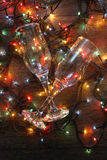 Glowing garland glass. Glowing garland lights dark background wire two glasses Royalty Free Stock Image
