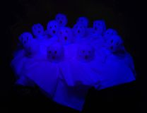 Glowing Ghosts. Lollipops dressed up for Halloween as glowing ghosts Stock Image