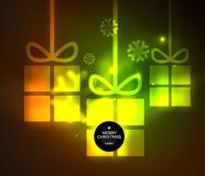 Glowing gift boxes with snowflakes, Christmas and New Year template. Vector illustration, winter holiday Christmas card with light effects Royalty Free Stock Image