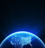Glowing globe at night Stock Photography
