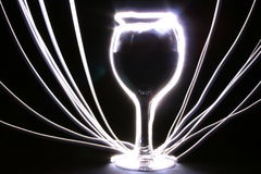 Glowing goblet with rays Stock Images