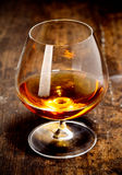Glowing goblet of rich cognac Royalty Free Stock Photos