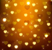 Glowing gold background with glowing hearts. Background with hearts and sparkles Stock Images