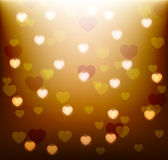 Glowing gold background with glowing hearts Royalty Free Stock Image