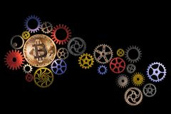 Glowing golden bitcoin and path of colorful cog wheels on black background with copy space. Royalty Free Stock Photos