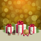 Glowing golden bokeh background and christmas gift boxes with decoration ball. Glowing bokeh background and christmas gift boxes Stock Images