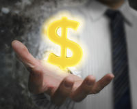 Glowing golden dollar sign in man's hand Royalty Free Stock Images