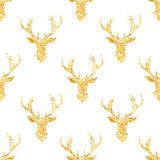 Glowing golden foil reindeer seamless vector pattern. Shimmering glitter simple and stylish celebration design print Stock Photo