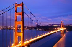 Glowing Golden Gate Bridge at dusk Stock Photography